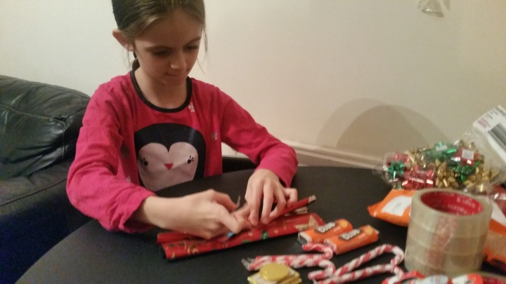 kids making easy teacher DIY gift chocolate Santa sleigh
