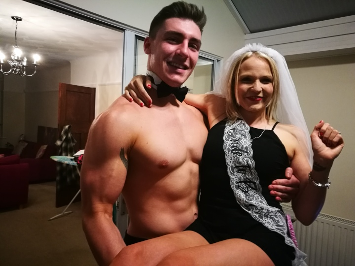 Butler in buff lifting bride