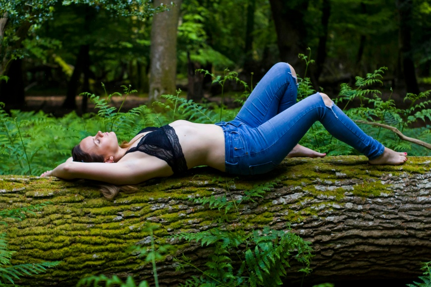 Embracing Femininity, women in lingerie & jeans on a tree in nature