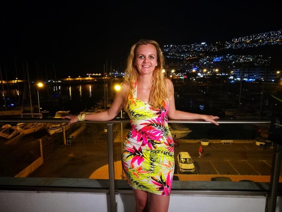 Bright dress balcony photo