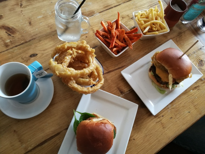 Indulgent foods burgers onion rings chips
